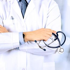Torso of doctor in white coat holding stethoscope illustrating a post on medical fetishism
